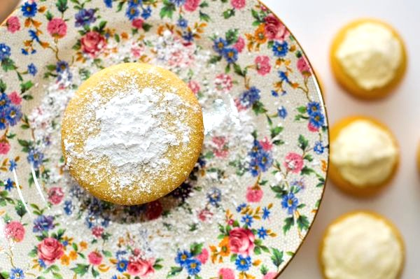 White Chocolate Cupcake with Powdered Sugar on Top